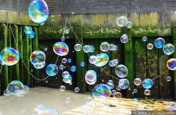 Bubbles over a Thames beach, London