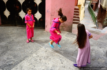 Arab girls playing on the border, Morocco.