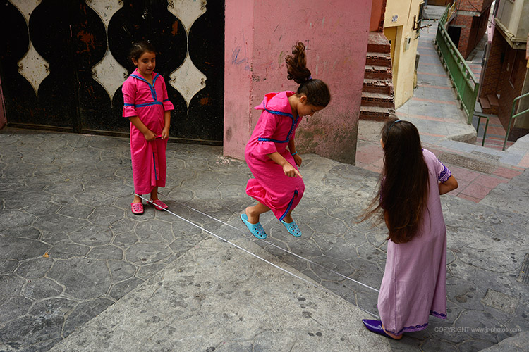Arab girls playing on the border between Morocco and Spain.